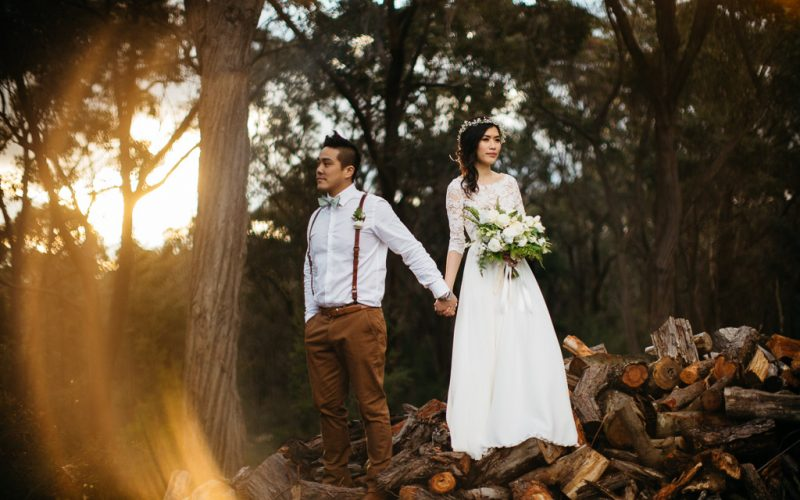 Jenny and Tung hold hands on the wedding day at Growwild in the Southern Highlands