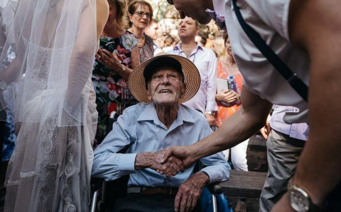 Photograph of a groom shaking hands with his grand father after a wedding ceremony at the Kangaroo Valley Bush Retreat.