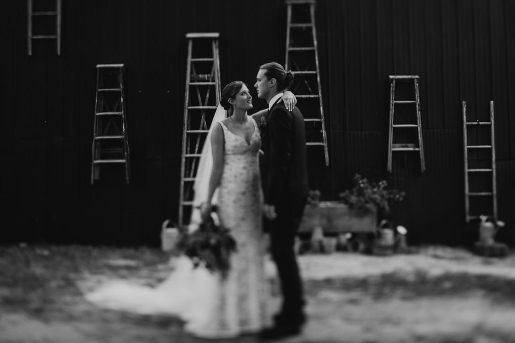 Black and white wedding photograph of Bride, Alex, and groom, Tom at their wedding at The Woods Farm on the south coast