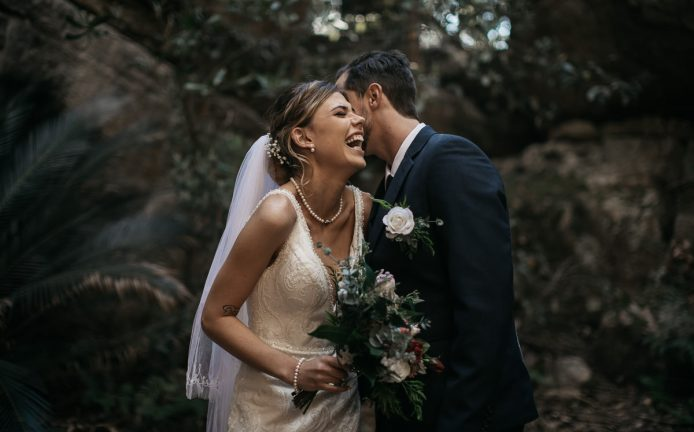 bride and groom share a funny secret; Kangaroo Valley Bush Retreat Wedding photography