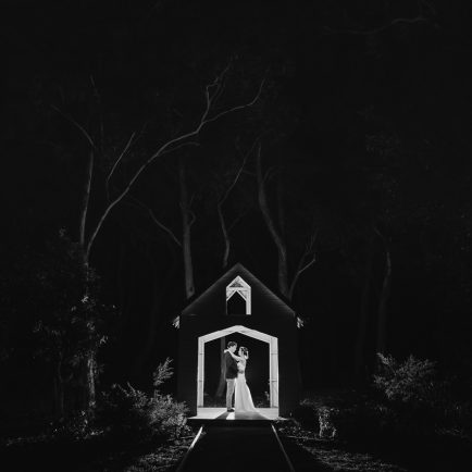 Black and white nighttime photograph of bride and groom in a mini house-shaped gazebo at Wildwood; kangaroo Valley Wedding Photographer South Coast